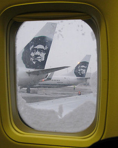 Just before take-off...the snow is beginning to accumulate, again.  After we were de-iced, we were able to take off.