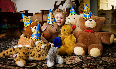 Wednesday, March 12, 2008  Ethan has a thing for stuffed animals.  He personalizes them to the extent that today he wanted to celebrate two of their birthdays.  He asked me for some old party hats from one of his past birthdays and we set up for a photo while singing happy birthday.  Then we discussed what each animal would want to eat for his birthday meal.  I believe Ethan is imaginative and tender-hearted.  But, I must admit that his interactions with his stuffed animals do make me wonder, sometimes, about what is going on in that cute, curly head!  I should probably mention that at least three of those animals were actually mine as a kid.  And I had one active imagination!  Oh, the stories these animals could tell!