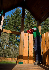 "March 11, 2008  Lovely spring day, although we did have moments of heavy showers as well.  Typical spring around here.  We spent some time outside this afternoon.  E's trying to look at me through his ""binoclears"" while I take some pics."