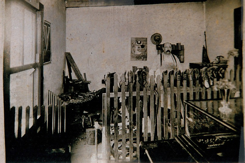 Beverly C. (BC) Robinson in his shoe shop in Brick Row. BC was the toll keeper of the Catawba River NC 73 to NC 150 bridge.  All of the bridges on the Catawba River were destroyed during the great flood of 1916, as was BC's home.  BC then moved his family to Cornelius.