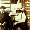 BC Robinson and Neil Goforth outside BC's shoe shop in Brick Row. ~1920.