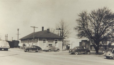 The Train Depot was located just north of Brick Row (near the current location of the CATS Park & Ride lot). Look closely at the picture and you will see a railroad spur north of the Depot that crossed Main Street to go to the mills.