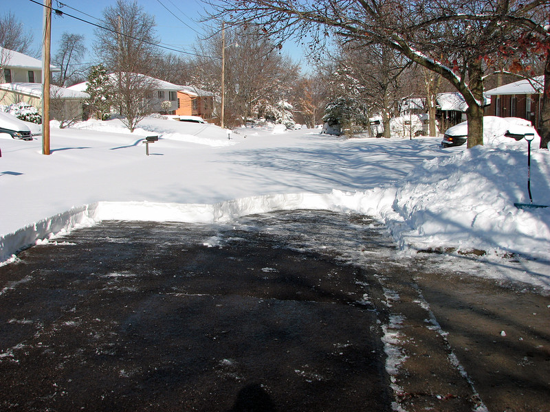 The bright sun did its job and quickly melted what residue remained after shoveling.