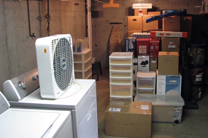 The utility room in the basement became the holding area for all of the boxes and containers.