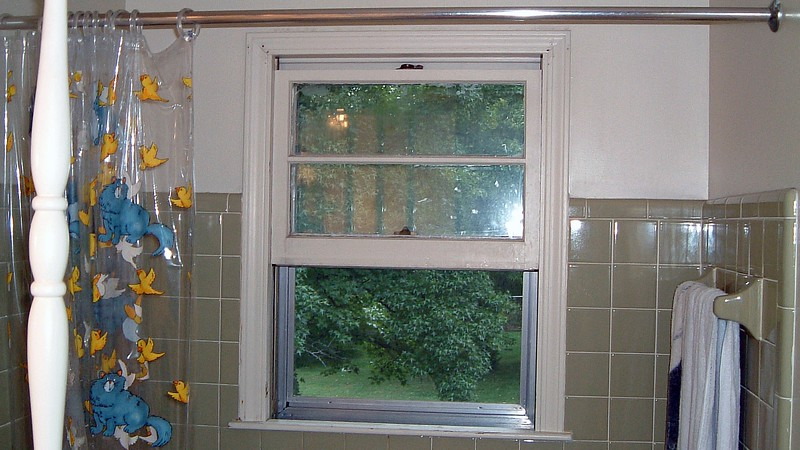 Today was the day both the window seen in the photo above and the basement sliding glass door were getting replaced.  I removed the wooden shutters in preparation for the contractor's arrival.