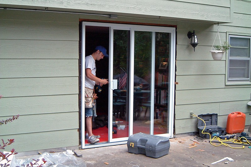 Installing the handle on the sliding half of the door.