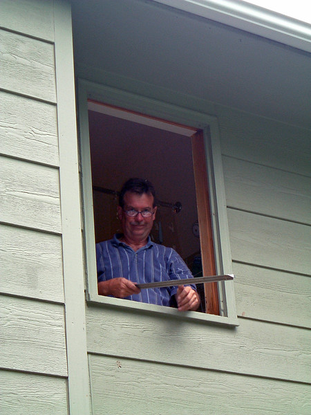 Steve got started on the bathroom window while his helper was finishing the sliding door.