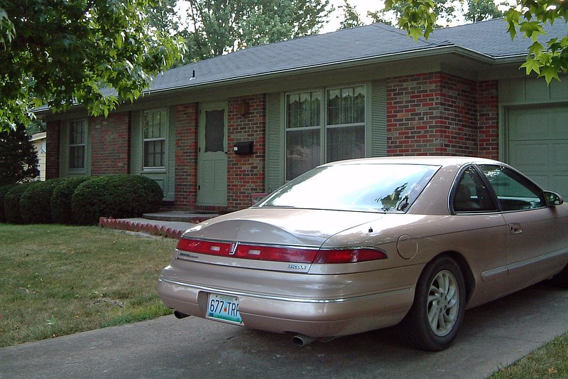 My wife's car gets the small garage, and the Mark VIII stays outside.