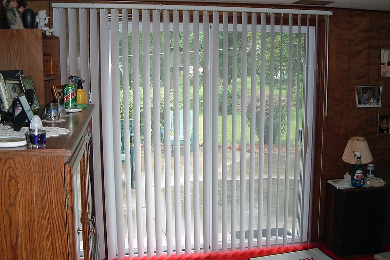 We went with blinds that were about a foot wider than the door opening.