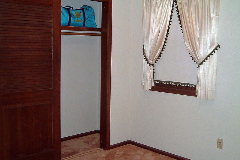 We decided to use this as our office.  And since there was only one closet in the master bedroom, this closet became mine.