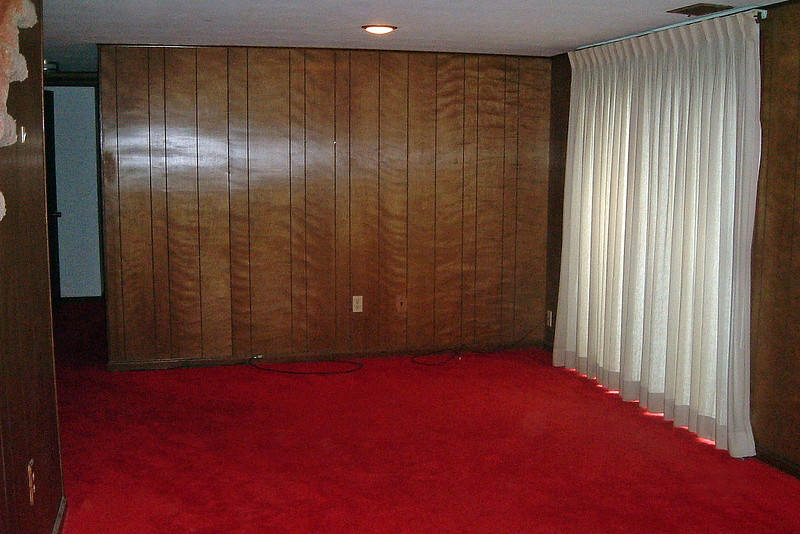 The very old bright red carpet was hard on the eyes.  But the room, itself was wonderful !  The curtains on the right side of the photo above lead to a patio and a large backyard.