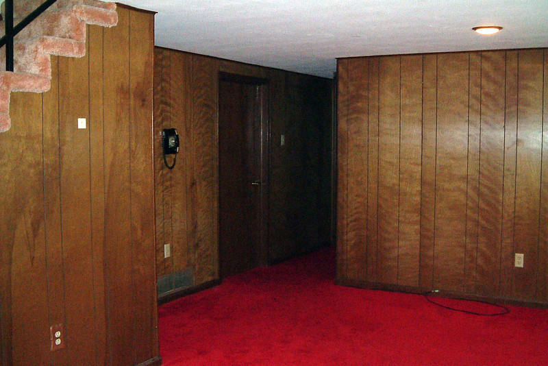 The hallway seen in the photo above leads to the third bedroom and bathroom.  The door in the photo leads to a large laundry and storage room.  And yes, that is a rotary dial phone on the wall.  And it worked !