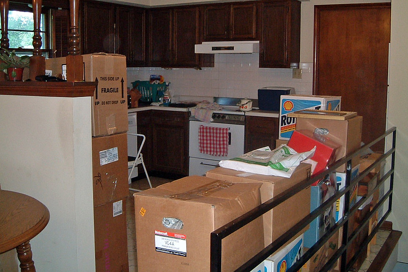 The boxes for the kitchen were stacked above the height of the railing.