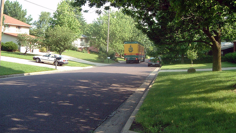 The size of the truck and the sharpness of the turns in the neighborhood meant the driver felt he was better off backing up the hill to our house.
