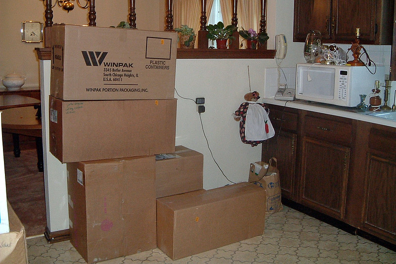 The moving crew began the long process of moving boxes into the house where either my wife or I would direct according to what was written on the outside of the box.  The boxes seen in the photo above were destined for the kitchen.