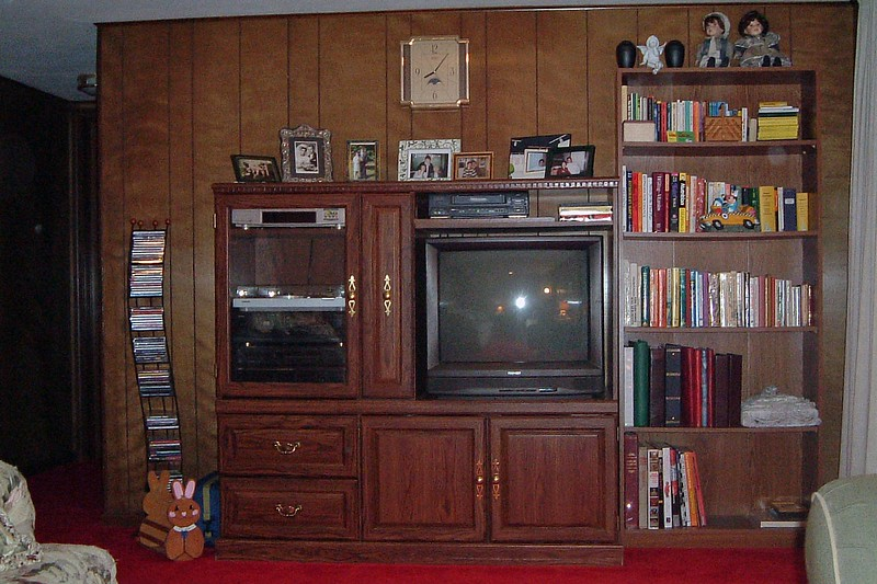 The large wall at the other end works well for the entertainment center and bookshelf.  The TV is a little far away from the seating, but it works fine.