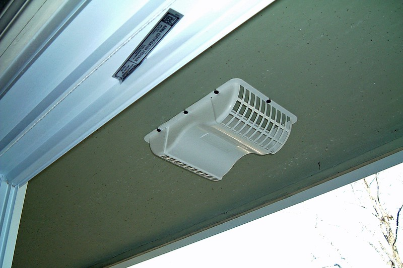 The new exhaust fan screen is installed.