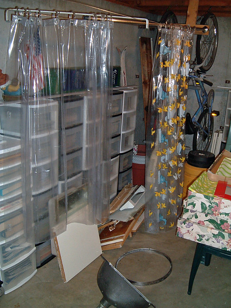 The curtains are new and will be reused.  Hanging them up in the basement utility room kept everything out of the way.