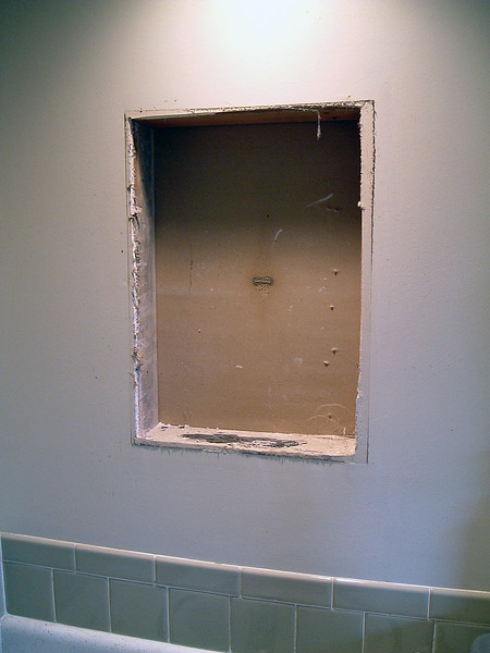 Removing the old medicine cabinet.