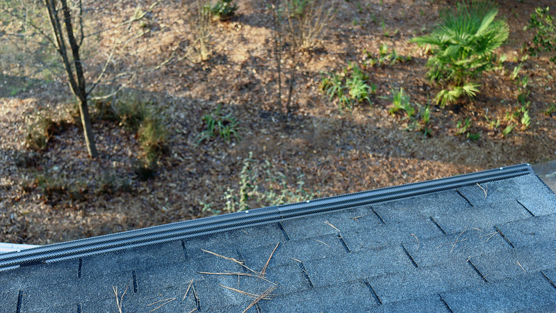 I scheduled time off of work over the Thanksgiving holiday and replaced the gutter guards along the garage roof.  Getting up on the garage roof is easy because it's not that high.  That project required one ladder, a few tools, the new parts, and one afternoon.