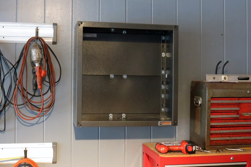 With the back of the cabinet mounted to the wall, the sides can be attached and secured.