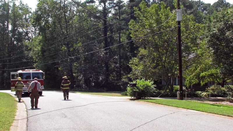 This means the electric power lines that cross the street are now too close to the ground.  The photo above shows the utility pole across the street from me.  The power and TV cable lines cross the street to another utility pole at the corner of my property, (which would be behind where I'm standing in the photo above).  The power line, which was still in place, can be seen at the top of the photo.
