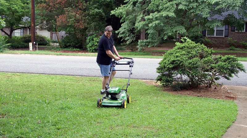 My father-in-law took a few pics of me getting my exercise during the inaugural mowing.