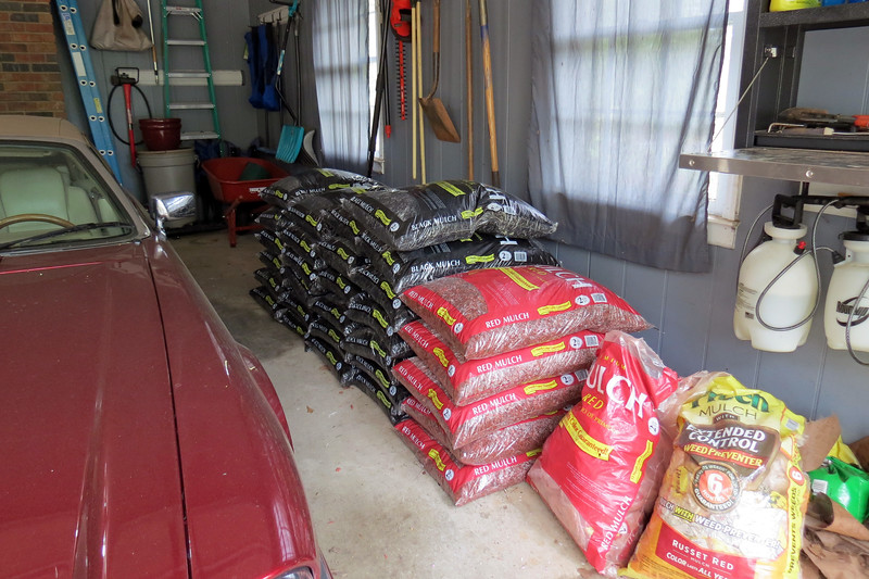 March 31:  Lowe's had Premium Mulch on sale this weekend.  I guessed that I would only need about 6 bags of red mulch to finish that part of the project.  After that, I could concentrate on filling in the individual plant clusters with black mulch.
