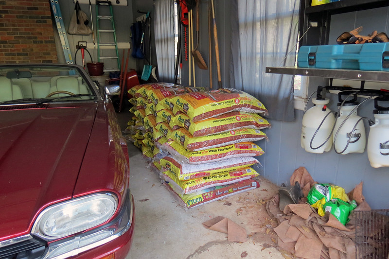 March 24:  Today began with several trips to Lowe's for mulch.  Preen mulch was on sale today.  Since the plan was to concentrate on the red mulch path, I bought a bunch of it.