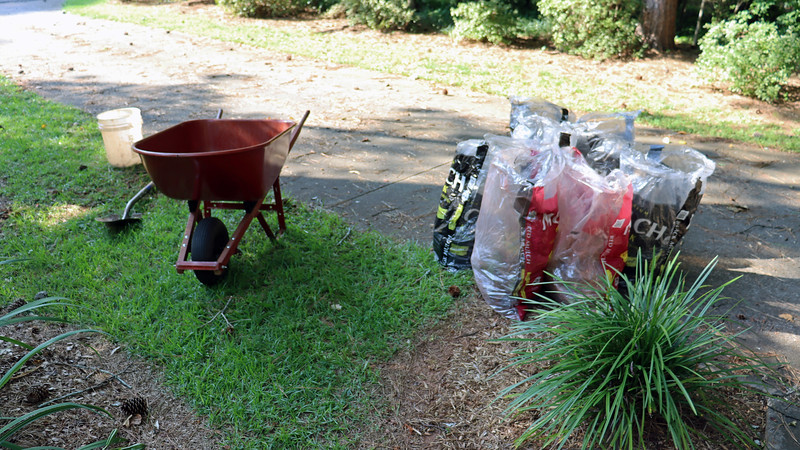Thanks to my neighborhood website, I was able to find several neighbors who were interested in having some of the newly divided irises.  The seven small bags of irises I prepared today took care of the first of what I anticipate to be several wheelbarrow loads of irises.