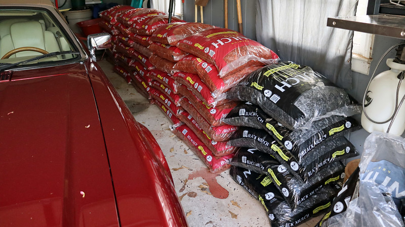 This weekend's project involved getting 5 additional bags of black mulch to finish the first phase of the project I started last weekend.  And since Lowe's had mulch on sale, I picked up a bunch of red mulch for the second phase of the project.