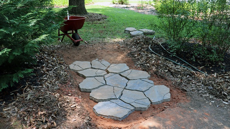 After several test fittings, I determined that 5 paver base mats and 18 paver stones would get the job done.