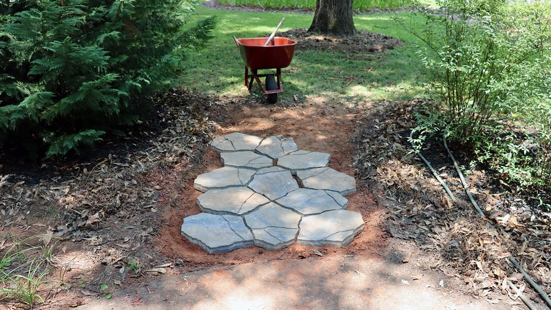 I'm sure a seasoned landscaper could calculate how many base mats and paver stones would be needed for this project.  But I am neither seasoned, nor a landscaper.  The only way I could figure this out was to do plenty of test fittings.
