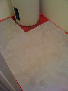 The easy part of lying down the tiles.  Now I have to cut strips to fit anywhere you can see red