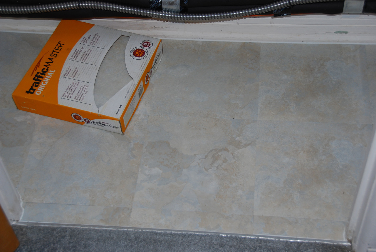 This is just a closet I used peel-n-stick tiles on.   Thats another electric able we have to do something about.
