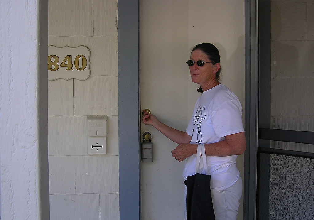 July 21, 2004.  Its Ours!  Carolyn unlocks the door to our new home.