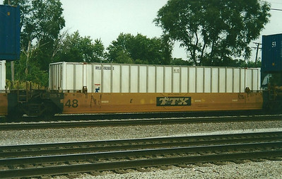 US 48' domestic box APLU492601 riding a well car at Dolton IL, September 2000.