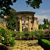 "TH-Rose Garden : The three and a half acre rose garden was designed by Myron Hunt and first planted by William Hertrich as a display garden in 1908. In the 1970s, the garden was reorganized as a ""collection garden"" with more than 1,200 cultivars (approx 4,000 individual plants) arranged historically to trace the development of roses from ancient to modern times beginning with the Egyptians, Greeks, and Romans."