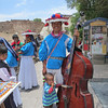 A Huichol Musician With His Son And Wife In Real de Catorce, San Luis Potosi