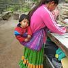 A Young Tarahumara Cave Dweller And Her Little Boy