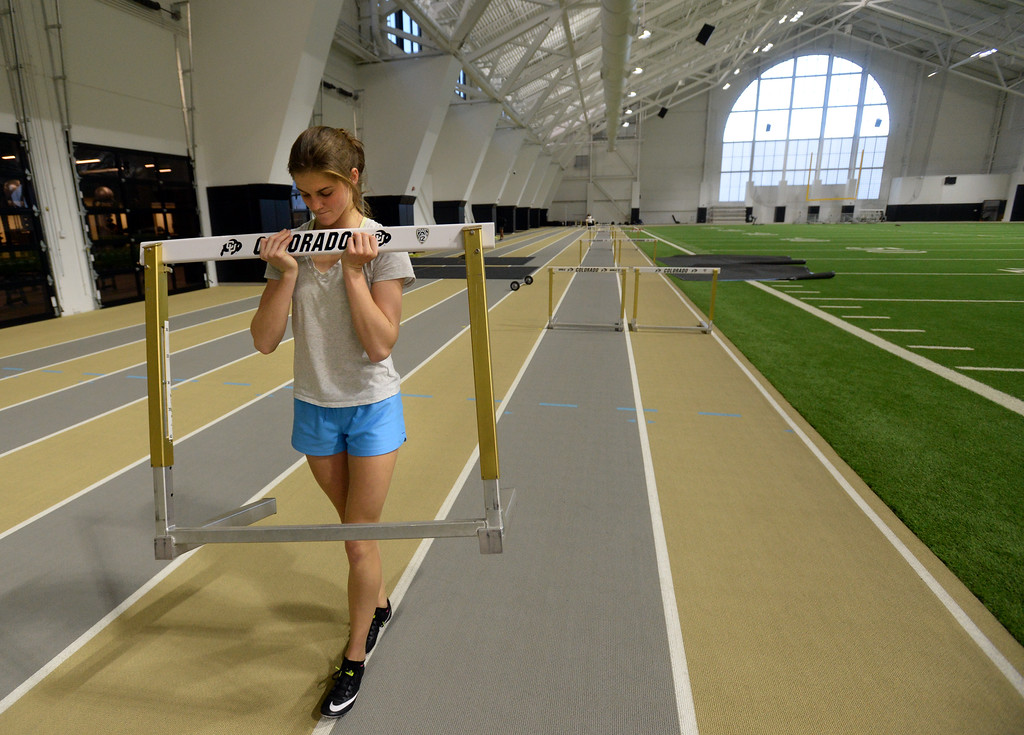 . Valerie Welch steps off distances between hurdles in the IPF on Friday. The athletic facilities at the University of Colorado are nationally recognized for sustainability, such as the Indoor Practice Facility (IPF).  Cliff Grassmick  Photographer December 15, 2017
