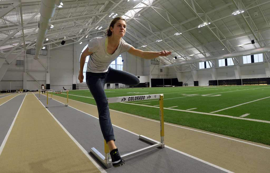 . Valerie Welch works out on the hurdles in the IPF on Friday. The athletic facilities at the University of Colorado are nationally recognized for sustainability, such as the Indoor Practice Facility (IPF).  Cliff Grassmick  Photographer December 15, 2017