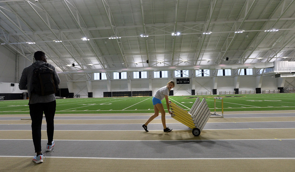 . Valerie Welch moves  hurdles  for a workout in the IPF on Friday. The athletic facilities at the University of Colorado are nationally recognized for sustainability, such as the Indoor Practice Facility (IPF).  Cliff Grassmick  Photographer December 15, 2017