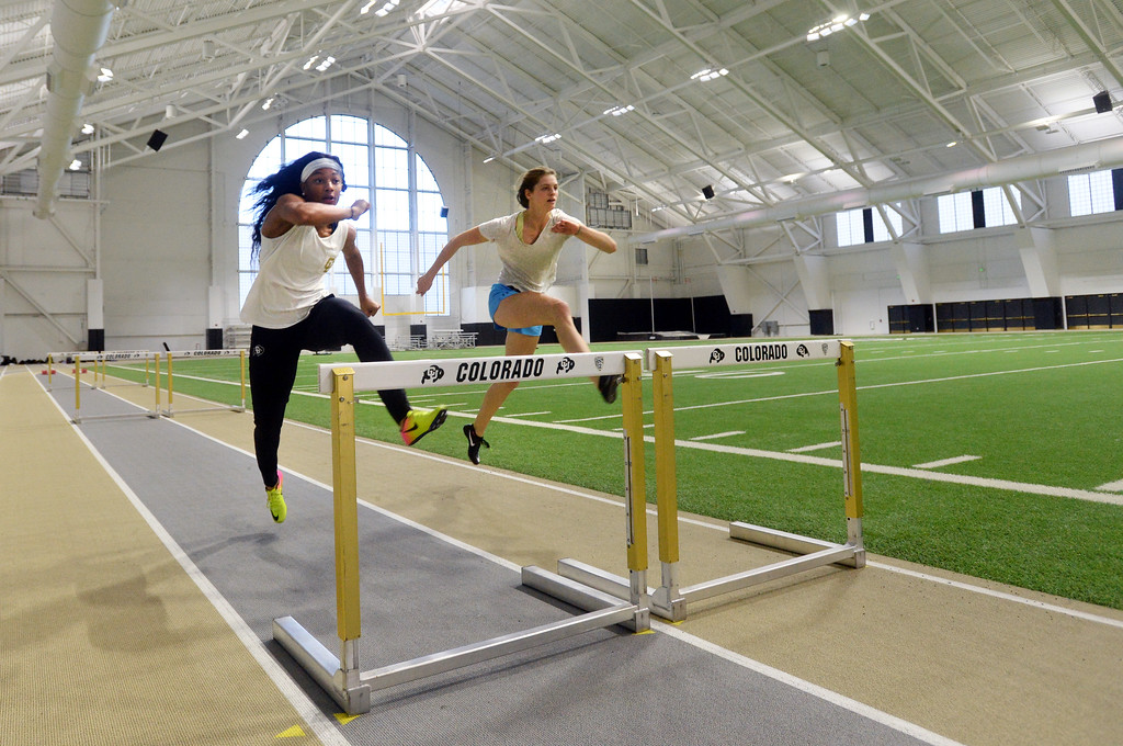 . Valerie Welch , left, and Eriana Henderson, run the hurdles in the IPF on Friday. The athletic facilities at the University of Colorado are nationally recognized for sustainability, such as the Indoor Practice Facility (IPF).  Cliff Grassmick  Photographer December 15, 2017