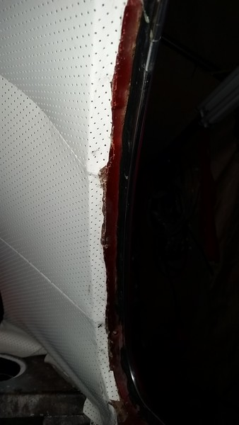 The excess headliner material has to be cut back so that the rear window/rubber will install on the small step in the body at the window opening.