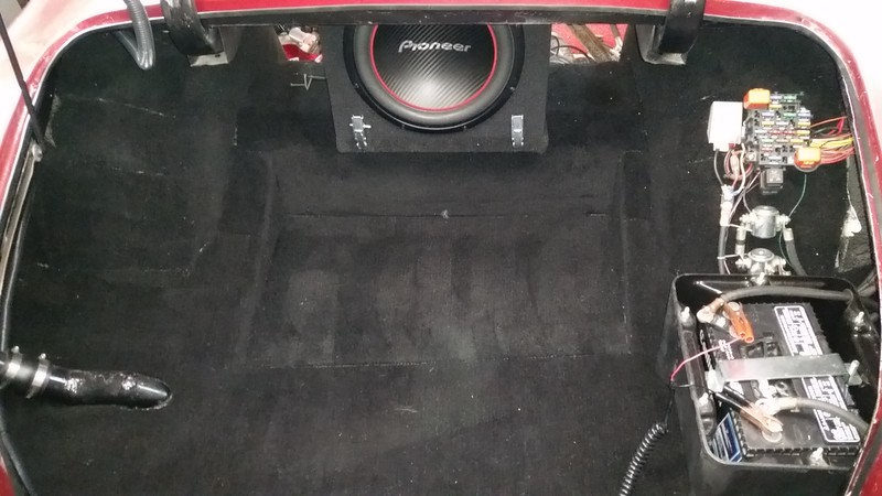 Relocated the subwoofer for more trunk space.