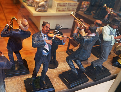 New Orleans, LA.   The French Quarter.   Jazz figures in a shop window.