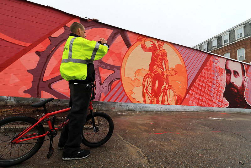 The new Iver Johnson mural in Fitchburg was completed on Sunday October 1, 2018. This picture was taken on Tuesday of the finished piece. A resident stopped to get a picture. SENTINEL & ENTERPRISE/JOHN LOVE