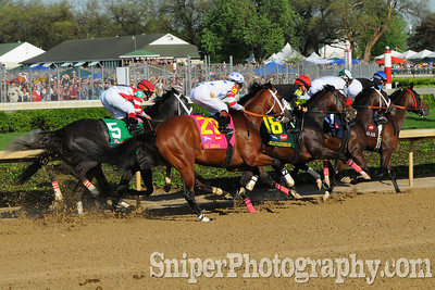 Big Brown, Eight Belles and the rest of the pack heading into the 2nd turn during the Kentucky Derby.