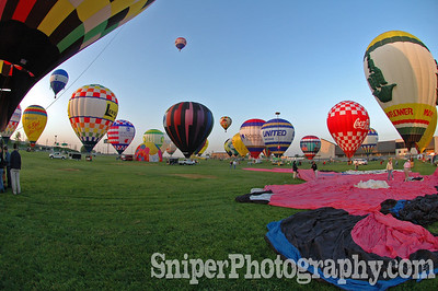 Balloons start to lift off during the Morning Rush Hour Balloon Race.